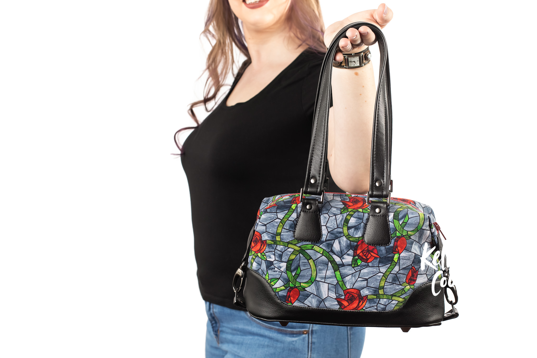 Woman holding a fun, geeky purse