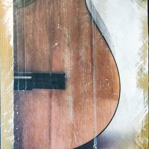 The bottom body of an acoustic guitar transferred to reclaimed wood