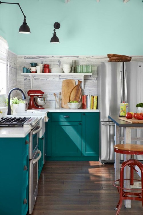 Painted Kitchen Cabinets Cabinetry Colorful Color Teal Shaker White Counters Turquoise Stainless Steel Fridge Refrigerator Kitchenaid Red Wood Floor Tile Wood Grain Backsplash Island Bar Stool Industrial Lights Lighting