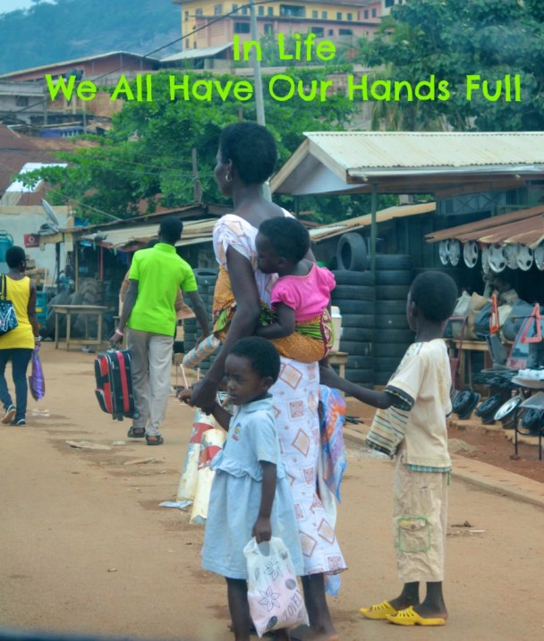 African Mom with her hands full