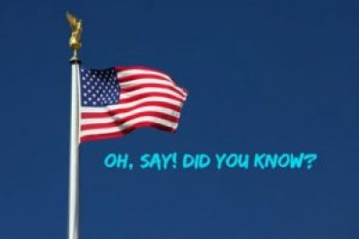 American flag with blue sky http://kellylmckenzie.com/the-surprising-truth-about-america/