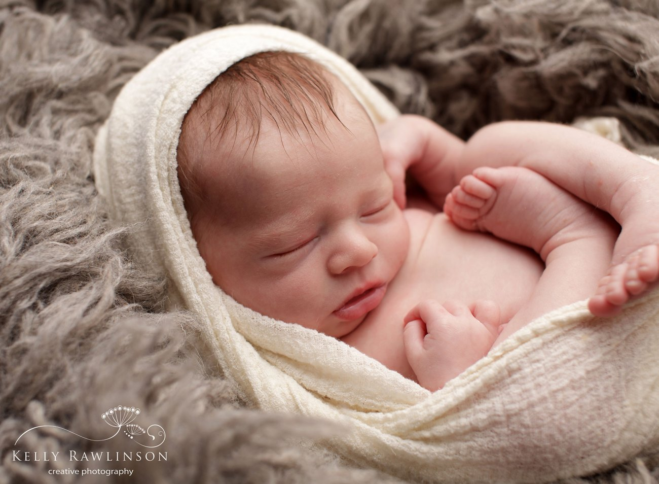 Awesome photo of baby wrapped in swaddle