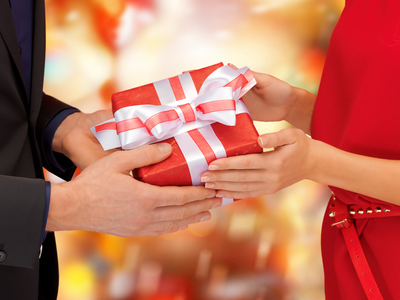man and woman hands with gift box