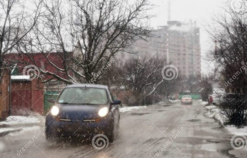 bad-weather-wet-road-covered-snow-car-goes-33920461
