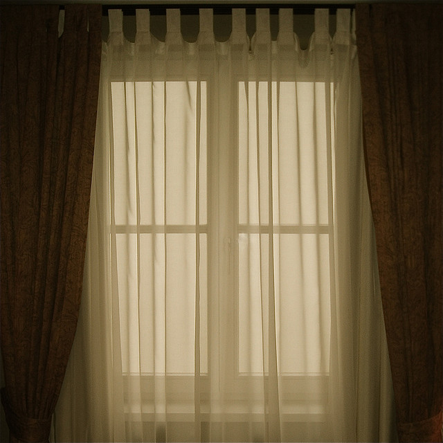 window_with_transluscent_curtains