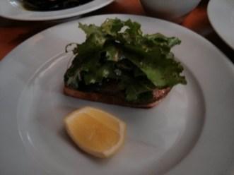 Field mushroom on olive toast, rocket, parmesan, truffle oil and lemon.