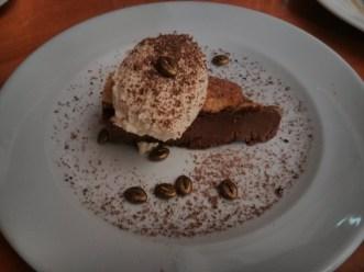 "Chocolate and hazelnut tart, ""ferrero rocher"" ice cream, cocoa nibs."