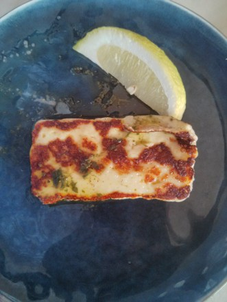 One slice of haloumi. Almost the same size as the slice of lemon.