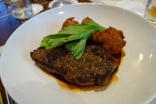 Creole mustard and herb crusted sirloin w potato beignets & beef jus