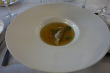 Double strength chicken and mushroom consomme with mushroom and shallot dumpling with chervil