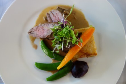 Whole roasted veal tenderloin, forest mushroom cream sauce, pommes dauphinoise, melody of glazed sugar snaps, baby carrot and baby beetroot