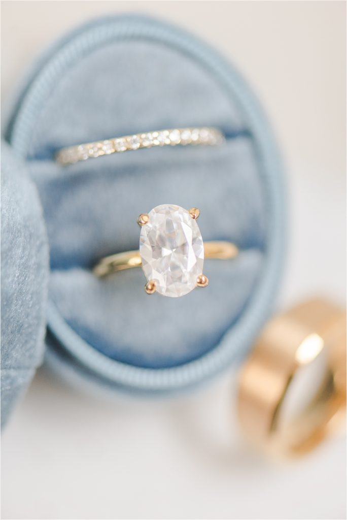 Dusty blue ring box with gold rings - Kansas City Wedding Photographer