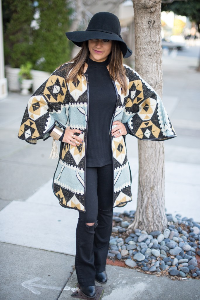 cape cardigan and black jeans