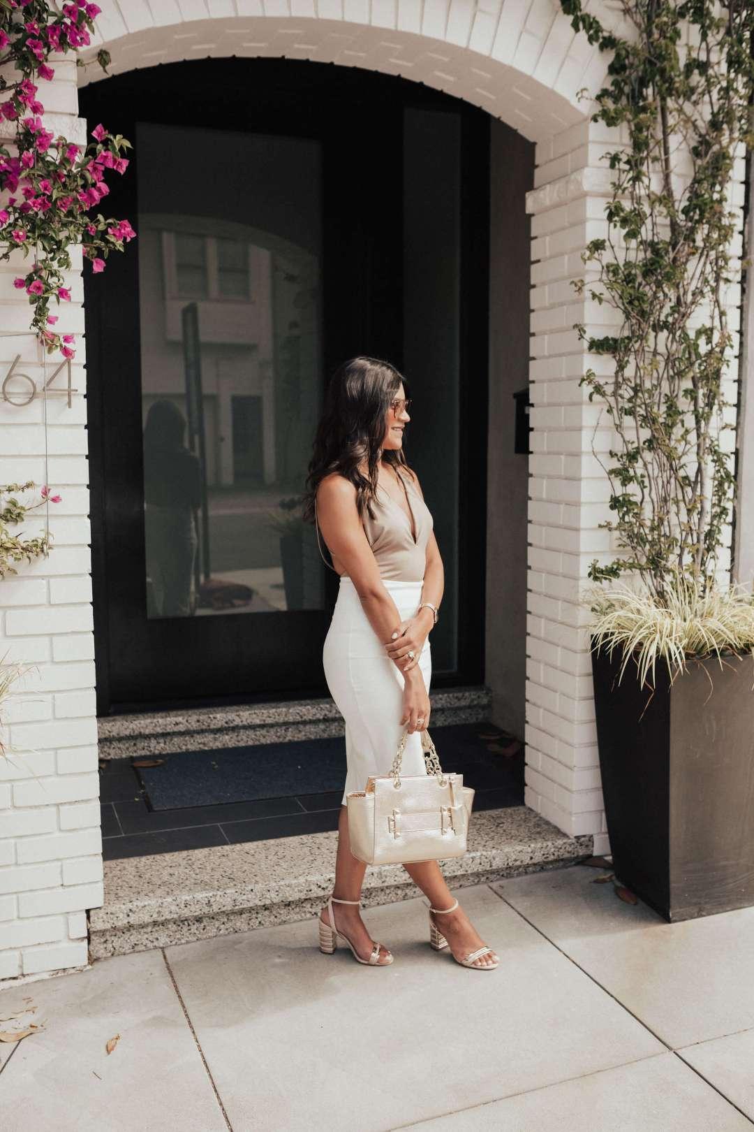 Life style blogger Kelsey Kaplan of Kelsey Kaplan Fashion wearing Rose Gold Raybans and beige bodysuit