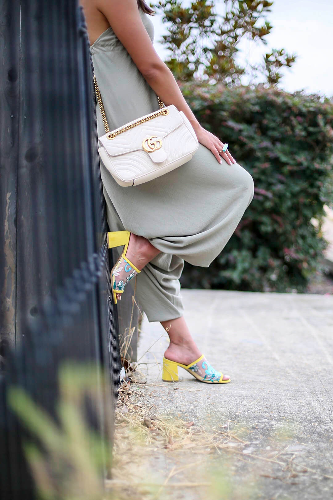 Lifestyle blogger Kelsey Kaplan of Kelsey Kaplan Fashion wearing drop crotch jumpsuit and seychelles mules