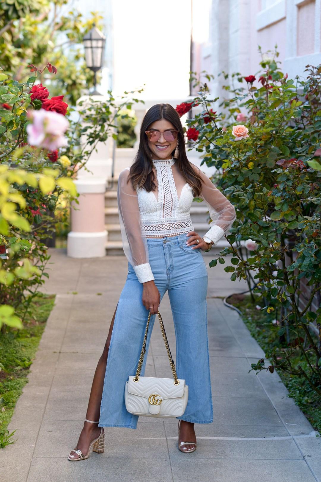 Life style blogger Kelsey Kaplan of Kelsey Kaplan Fashion wearing rose gold sunglasses and side slit jeans