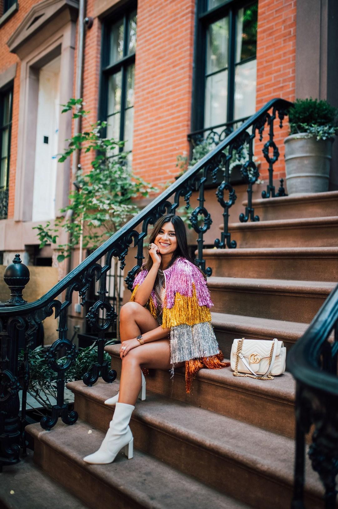 Lifestyle blogger Kelsey Kaplan of Kelsey Kaplan Fashion wearing tinsel fringe jacket and white Gucci Purse