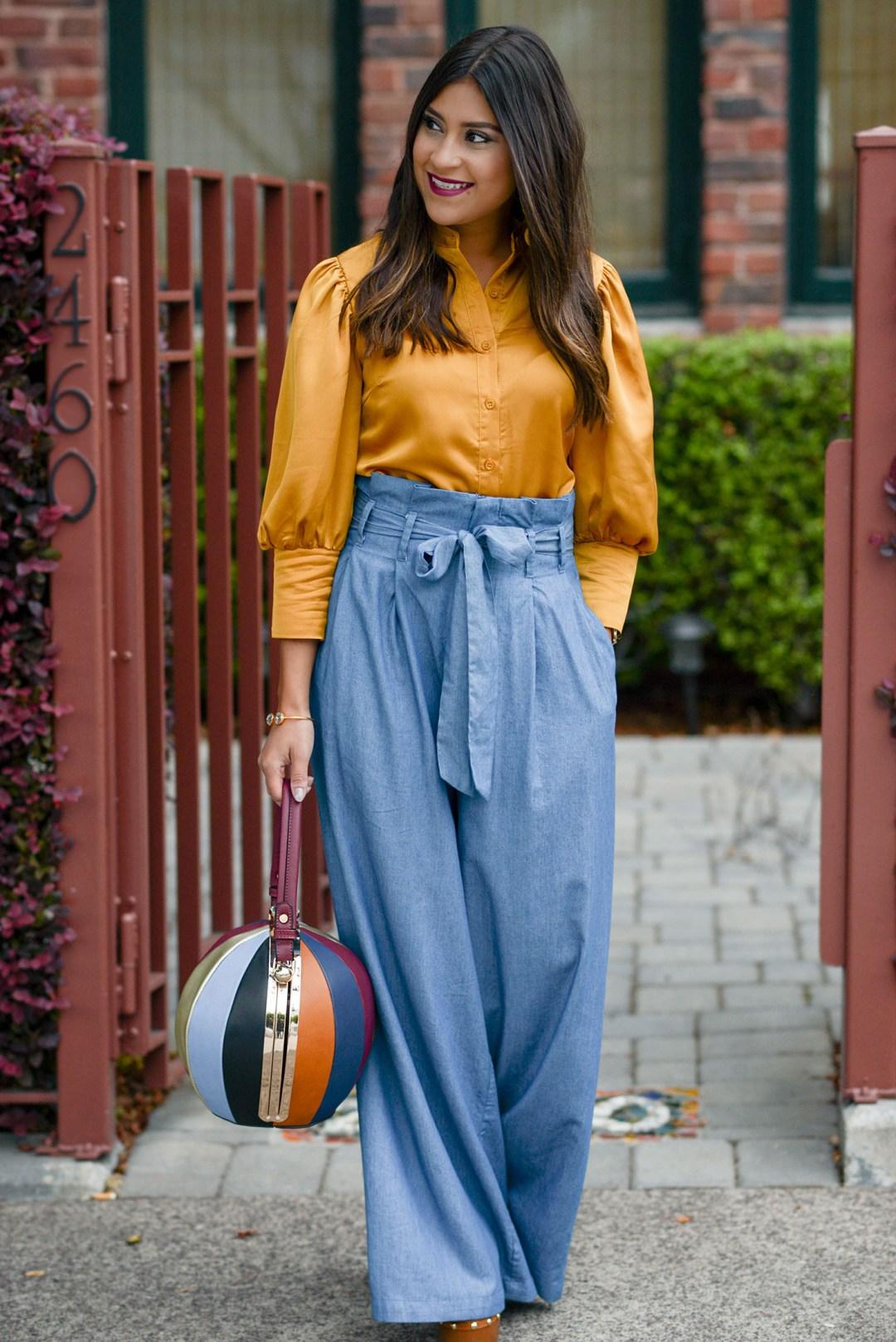 Lifestyle blogger Kelsey Kaplan of Kelsey Kaplan Fashion wearing wide leg pants and bowling ball bag