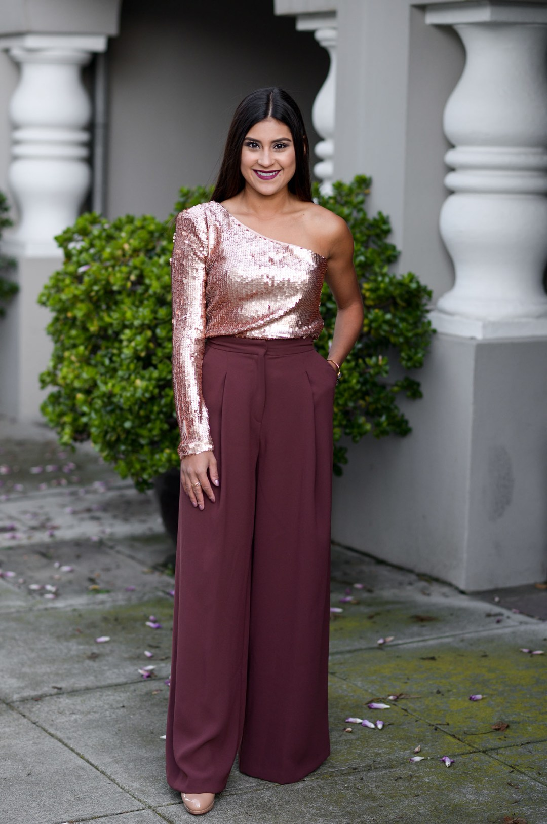 Lifestyle blogger Kelsey Kaplan of Kelsey Kaplan Fashion wearing River Island pants and sequin top for Thanksgiving outfit