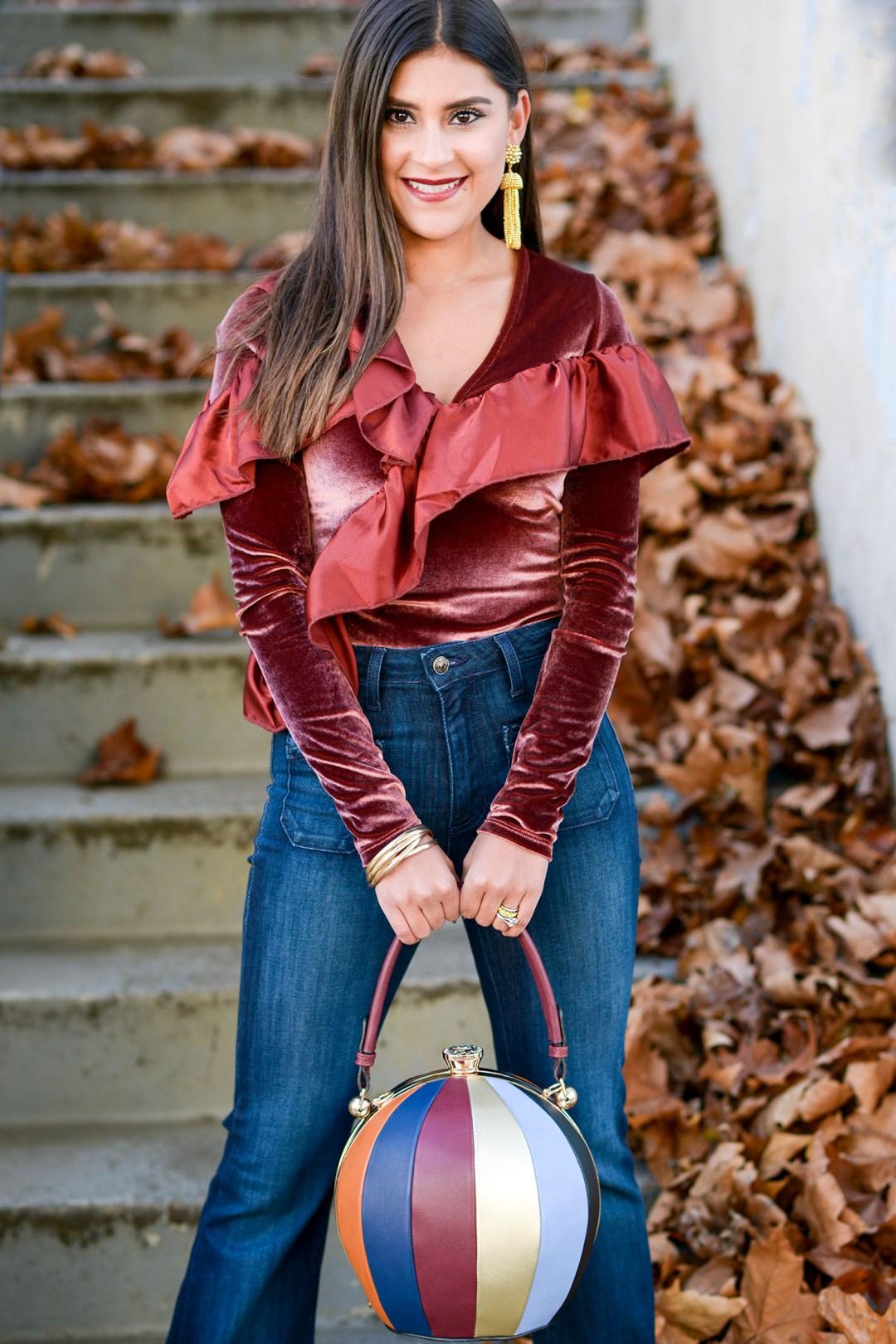 Lifestyle blogger Kelsey Kaplan of Kelsey Kaplan Fashion wearing velvet bodysuit and gold Lisi Lerch earrings