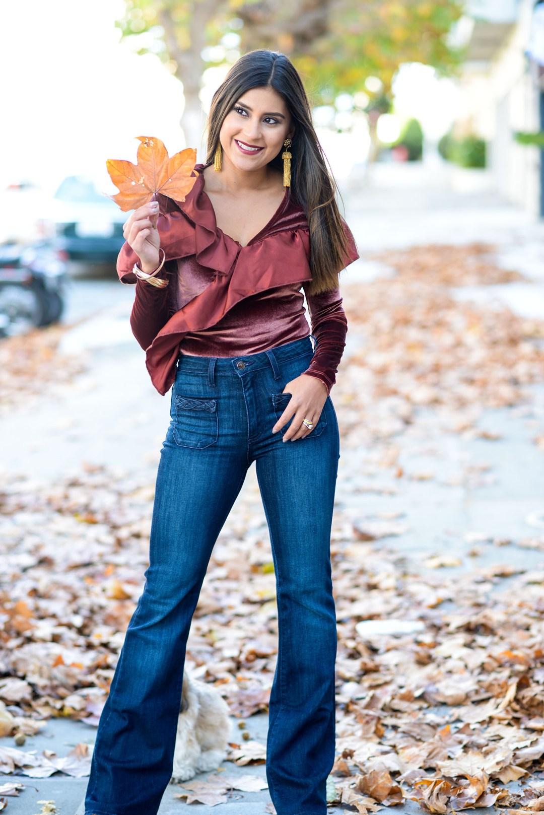 Lifestyle blogger Kelsey Kaplan of Kelsey Kaplan Fashion wearing velvet bodysuit and gold tassel Lisi Lerch earrings