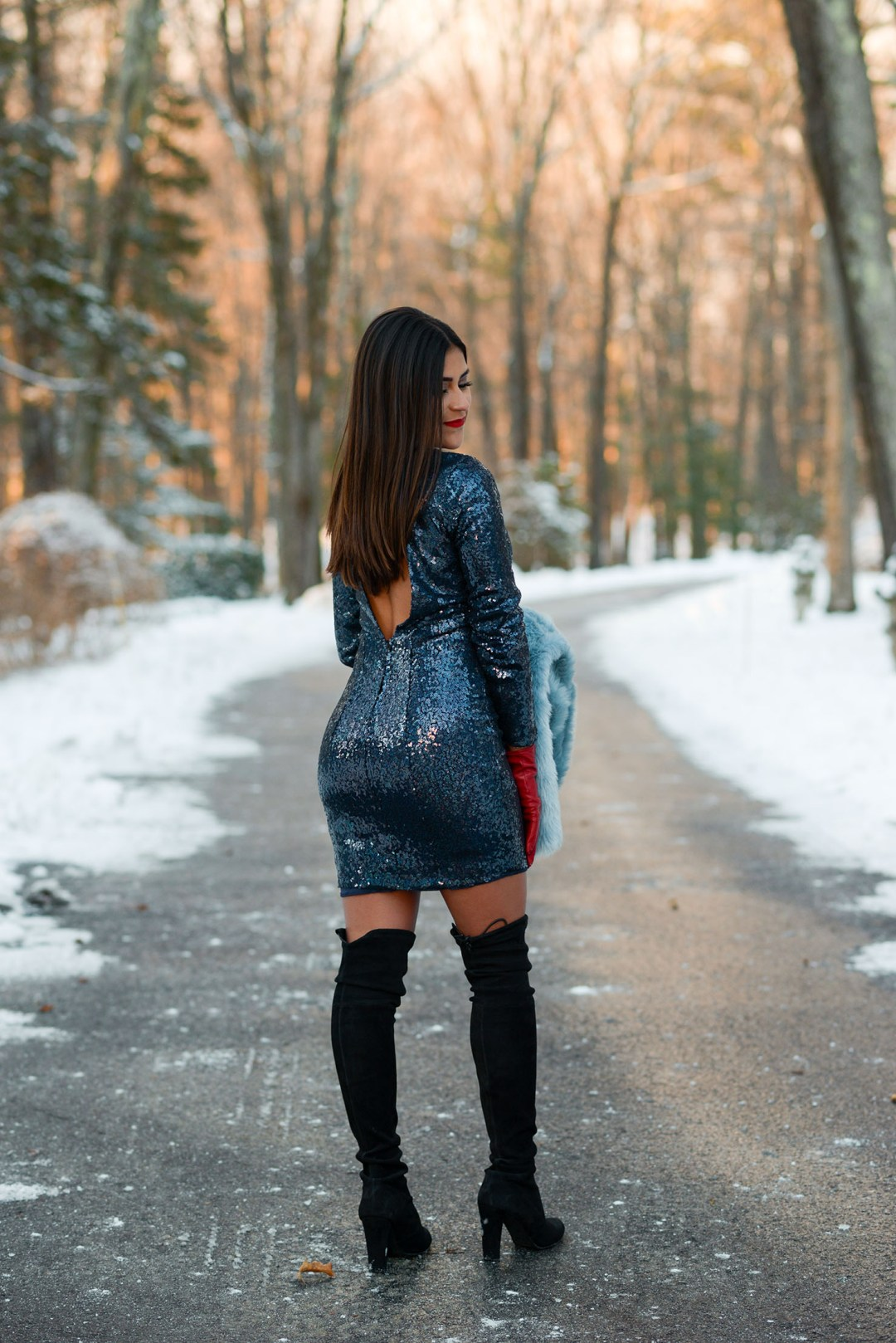 Lifestyle blogger Kelsey Kaplan Fashion wearing blue sequin dress for New Year's Eve 2017 and Stuart Weitzman over the knee boots