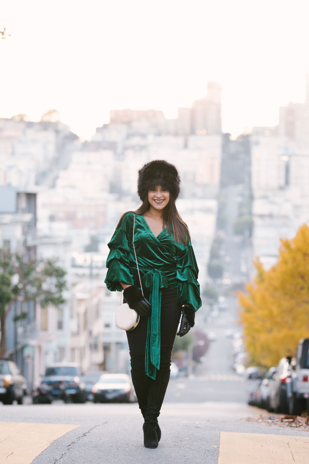 Lifestyle blogger Kelsey Kaplan of Kelsey Kaplan Fashion wearing emerald velvet top and Stuart Weitzman over the knee boots