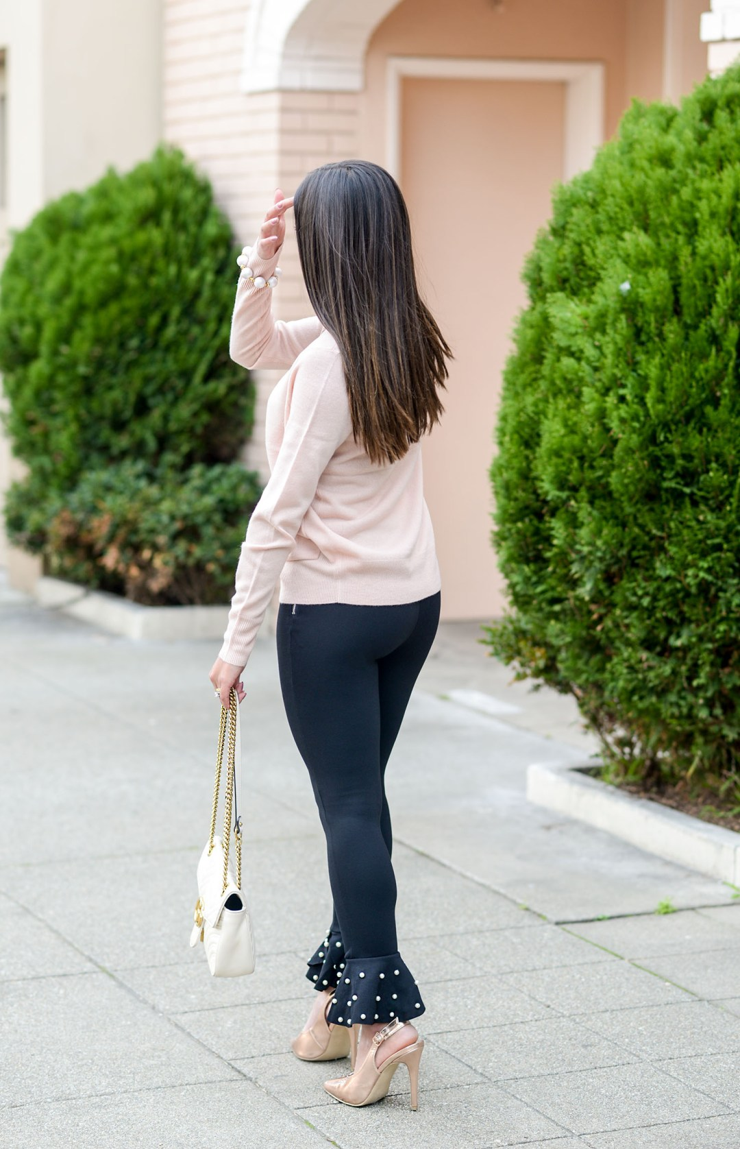 Lifestyle blogger Kelsey Kaplan of Kelsey Kaplan Fashion wearing pearl hem pants and white gucci purse