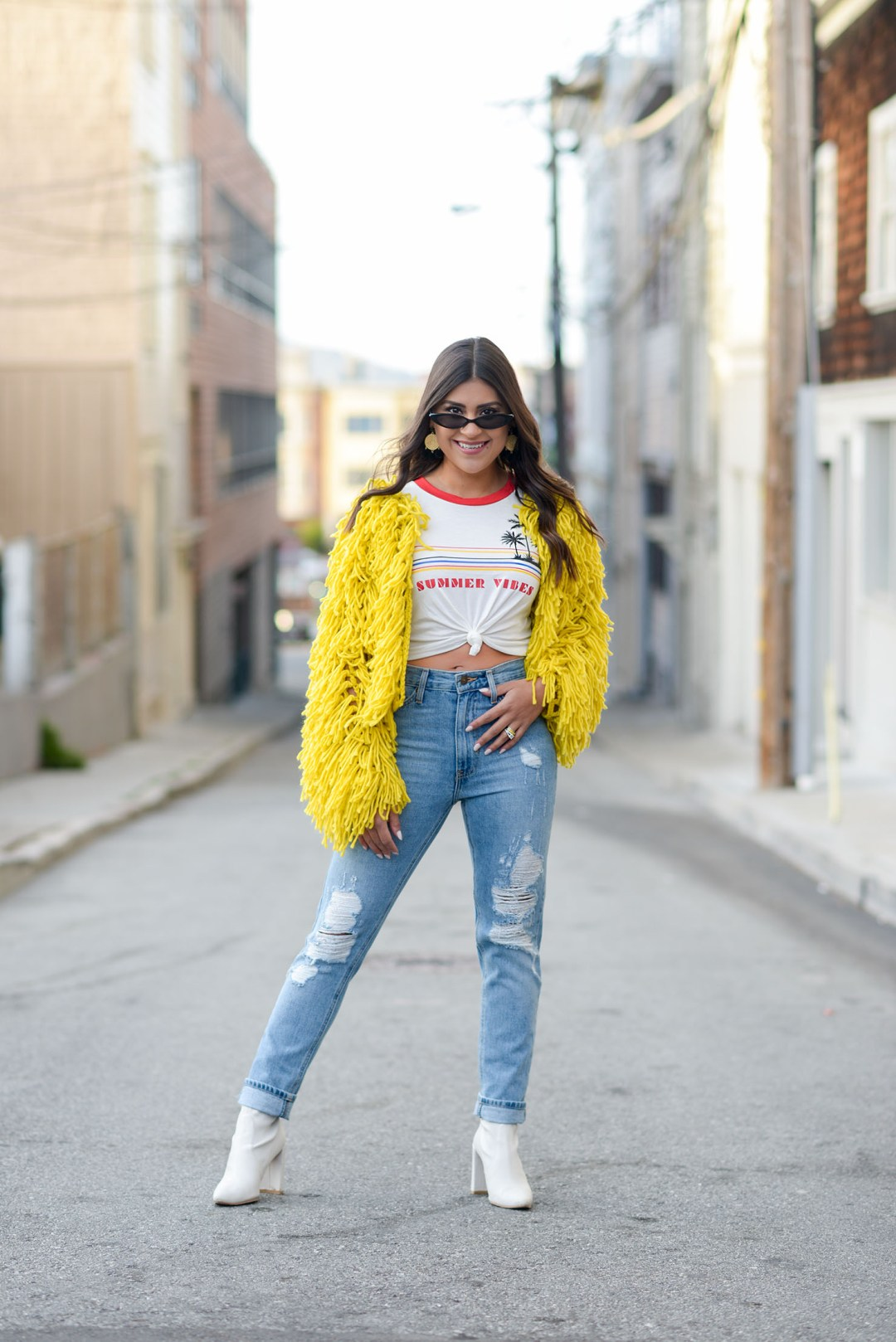 Lifestyle blogger Kelsey Kaplan of Kelsey Kaplan Fashion wearing mom jeans and Stuart Weitzman Clinger booties