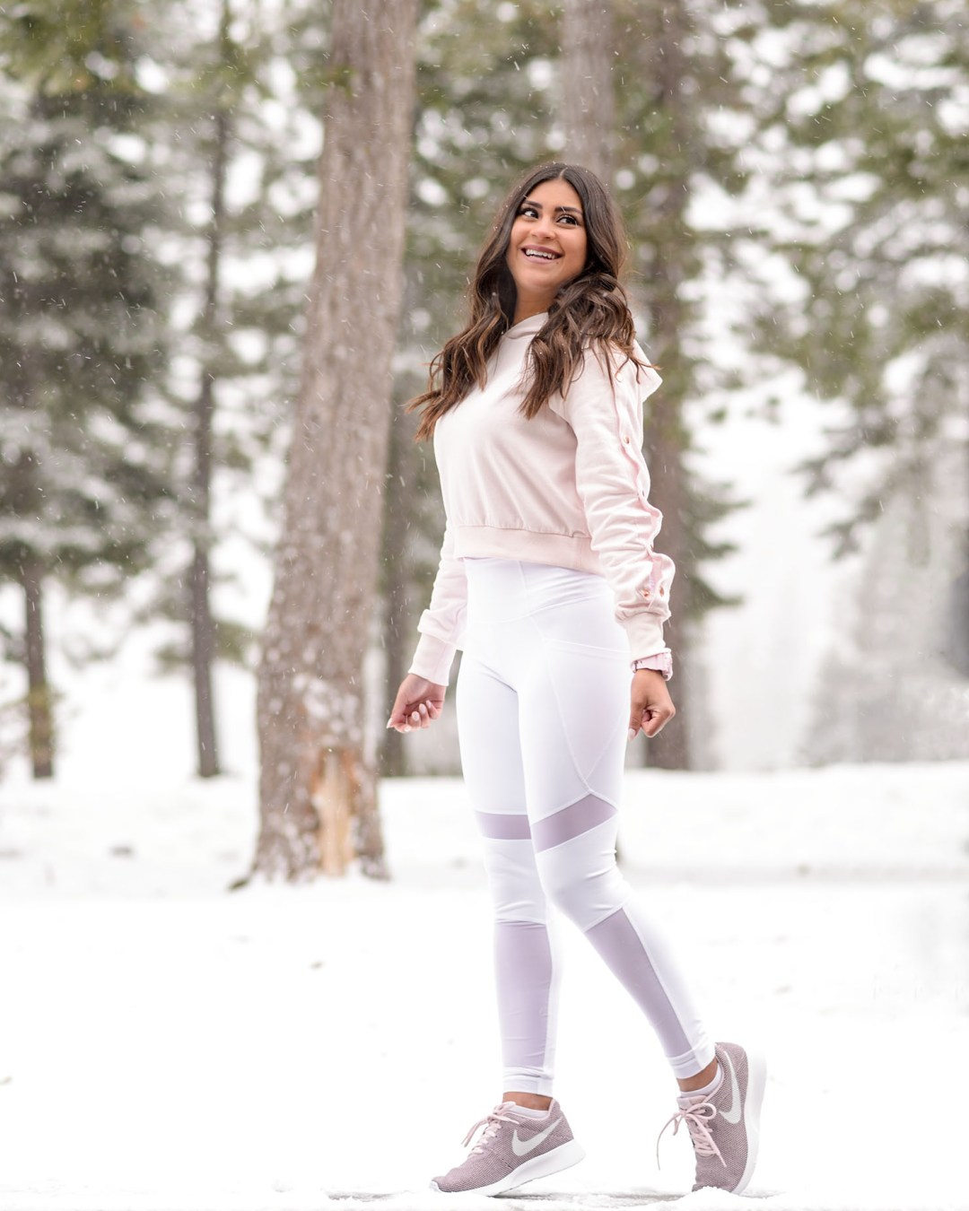 lifestyle blogger Kelsey Kaplan of Kelsey Kaplan Fashion wearing white yoga pants and Nike Tanjun sneakers