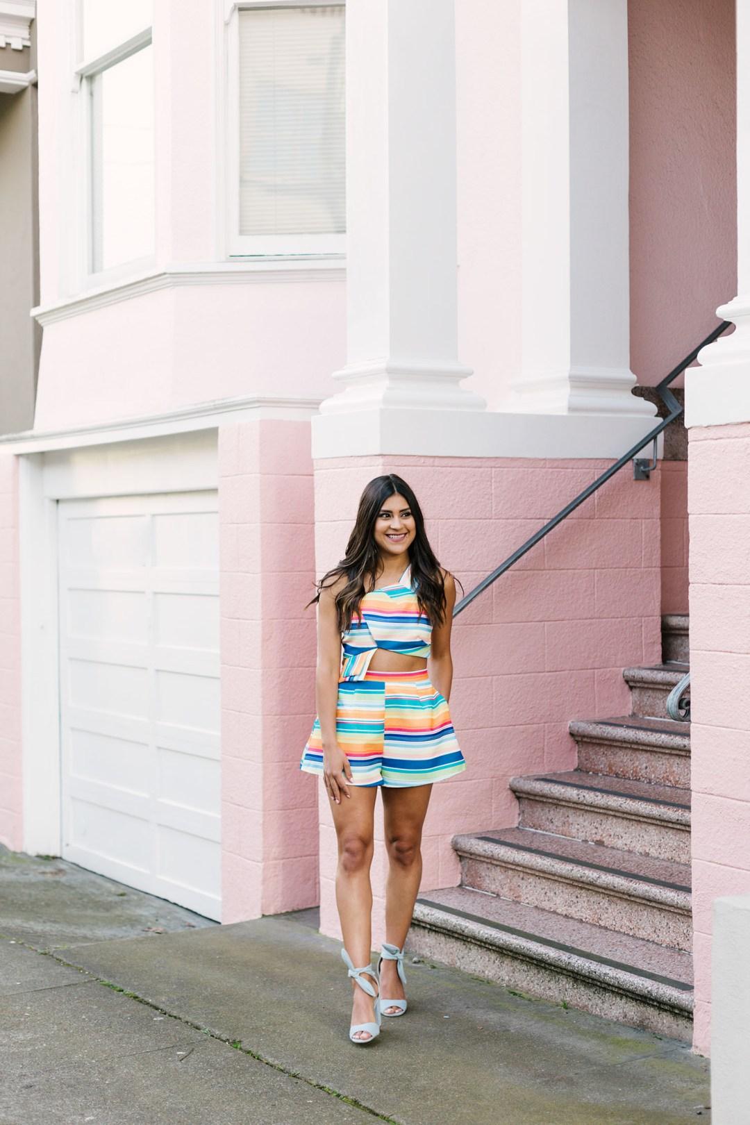 Lifestyle blogger Kelsey Kaplan of Kelsey Kaplan Fashion wearing striped two piece set and denim sandals
