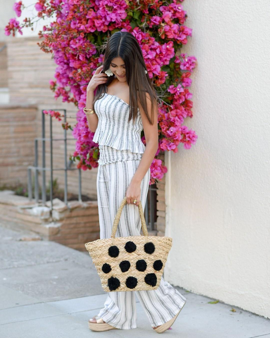 Lifestyle blogger Kelsey Kaplan of Kelsey Kaplan Fashion wearing pom pom straw bag