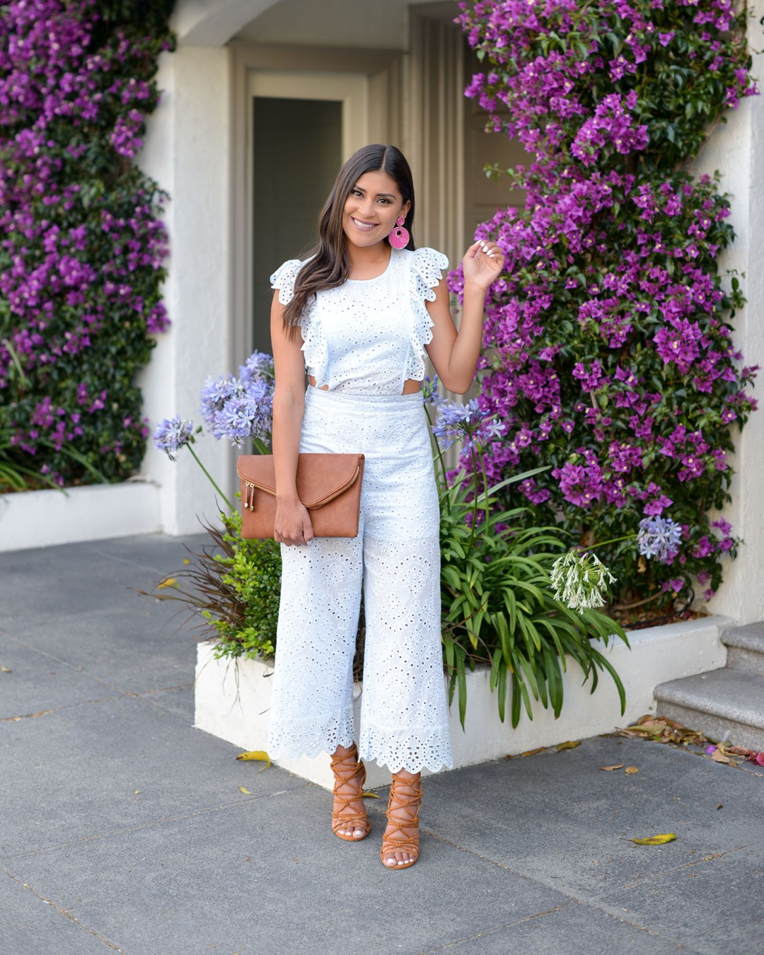 Lifestyle blogger Kelsey Kaplan of Kelsey Kaplan Fashion wearing eyelet jumpsuit from VICI