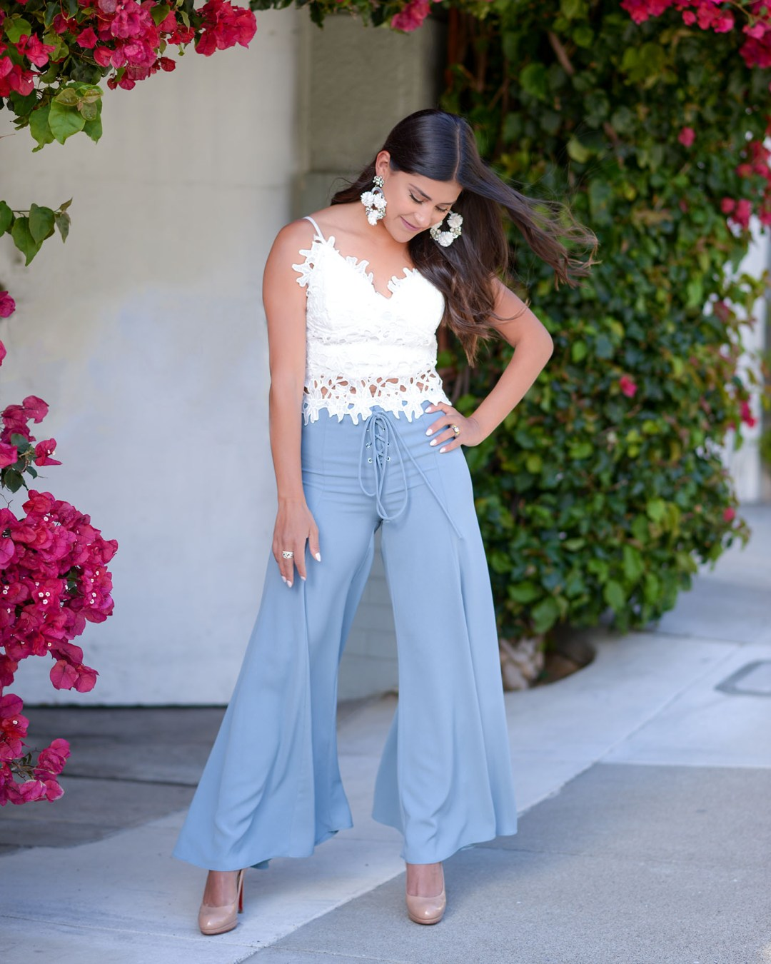 Lifestyle blogger Kelsey Kaplan of Kelsey Kaplan Fashion wearing blue wide leg pants and nude Louboutin pumps