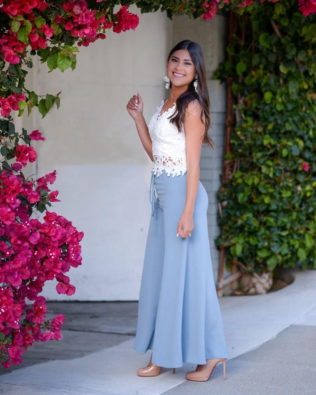 Lifestyle blogger Kelsey Kaplan of Kelsey Kaplan Fashion wearing blue wide leg pants and nude Louboutin pumps
