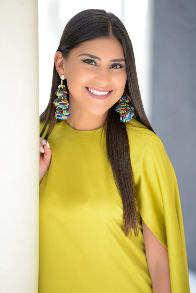 Lifestyle blogger Kelsey Kaplan of Kelsey Kaplan Fashion wearing chartreuse cape dress and rainbow Louboutins pumps.