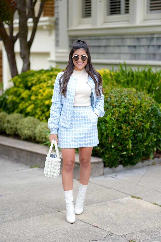 Lifestyle blogger Kelsey Kaplan of Kelsey Kaplan Fashion wearing houndstooth suit and pearl beaded purse