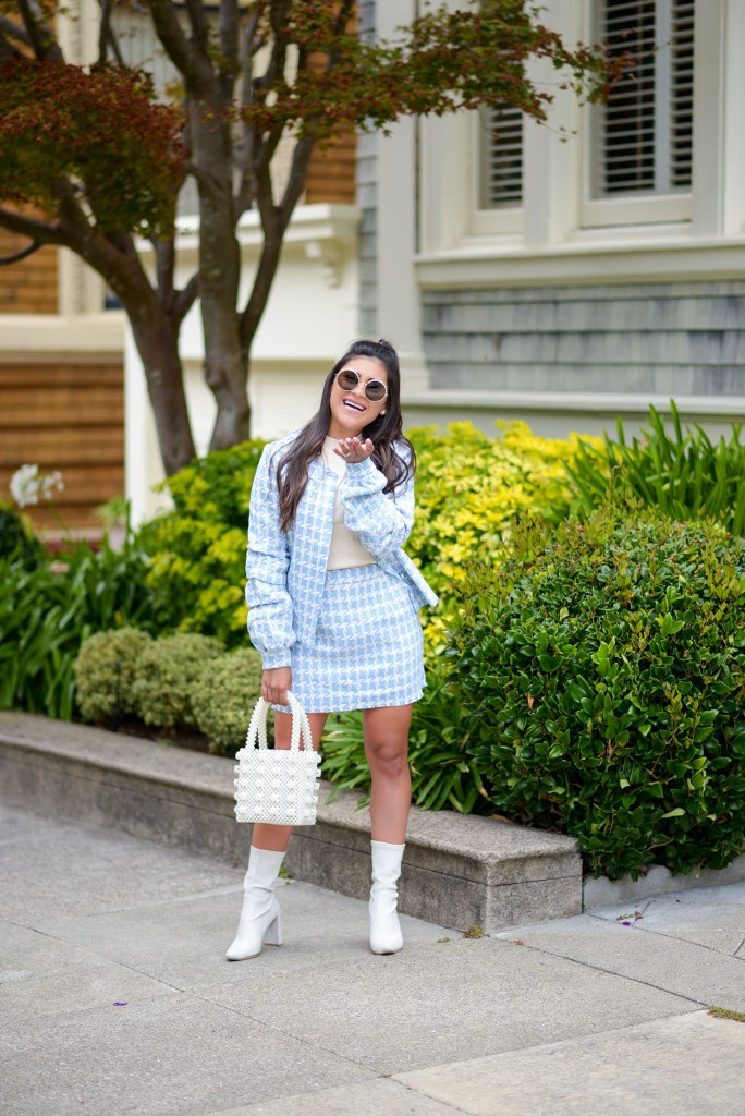 Lifestyle blogger Kelsey Kaplan of Kelsey Kaplan Fashion wearing houndstooth suit and pearl Chanel sunglasses