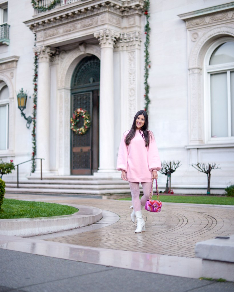lifestyle blogger Kelsey Kaplan of Kelsey Kaplan Fashion wearing pink sweatshirt dress and Gucci purse