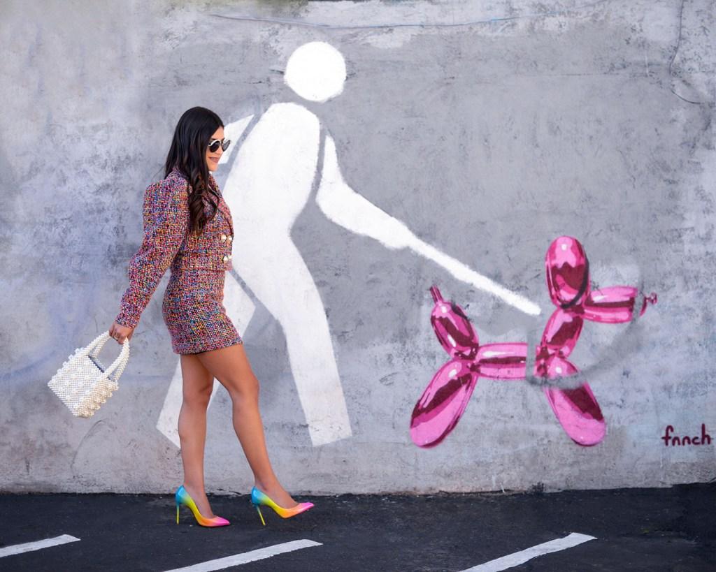 Lifestyle blogger Kelsey Kaplan of Kelsey Kaplan Fashion wearing rainbow tweed suit and pearl beaded purse
