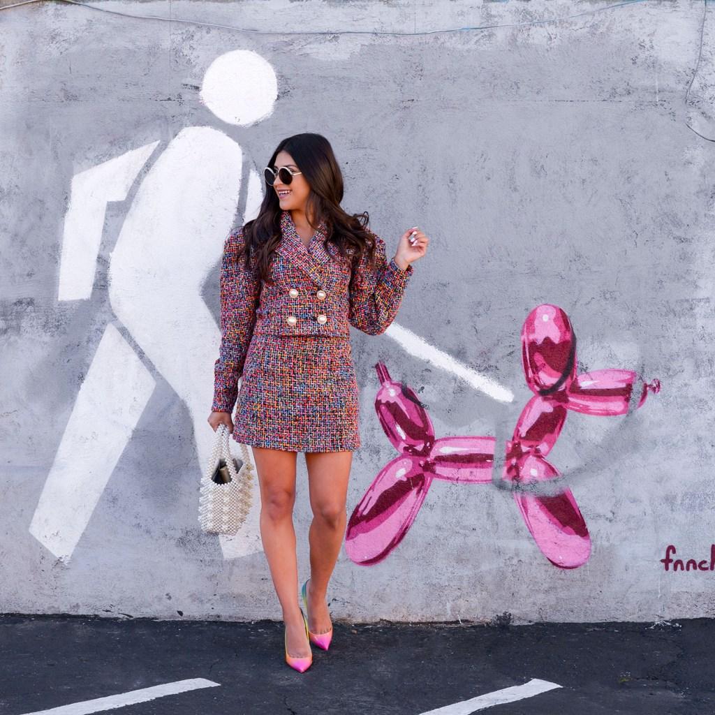 Lifestyle blogger Kelsey Kaplan of Kelsey Kaplan Fashion wearing rainbow tweed suit and rainbow pumps