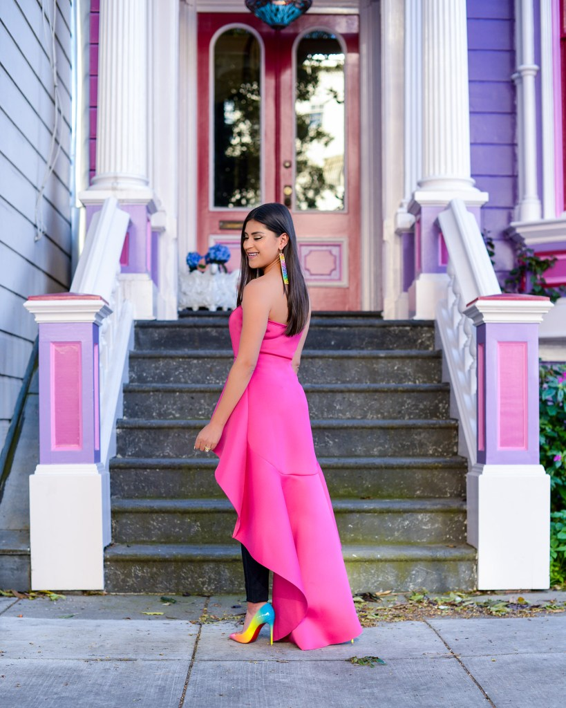 Lifestyle blogger Kelsey Kaplan of Kelsey Kaplan Fashion wearing magenta high-low top and rainbow Louboutins