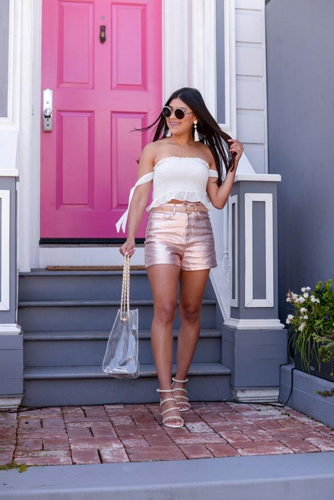 Lifestyle blogger Kelsey Kaplan of Kelsey Kaplan Fashion wearing pink mom shorts and Chanel pearl sunglasses.