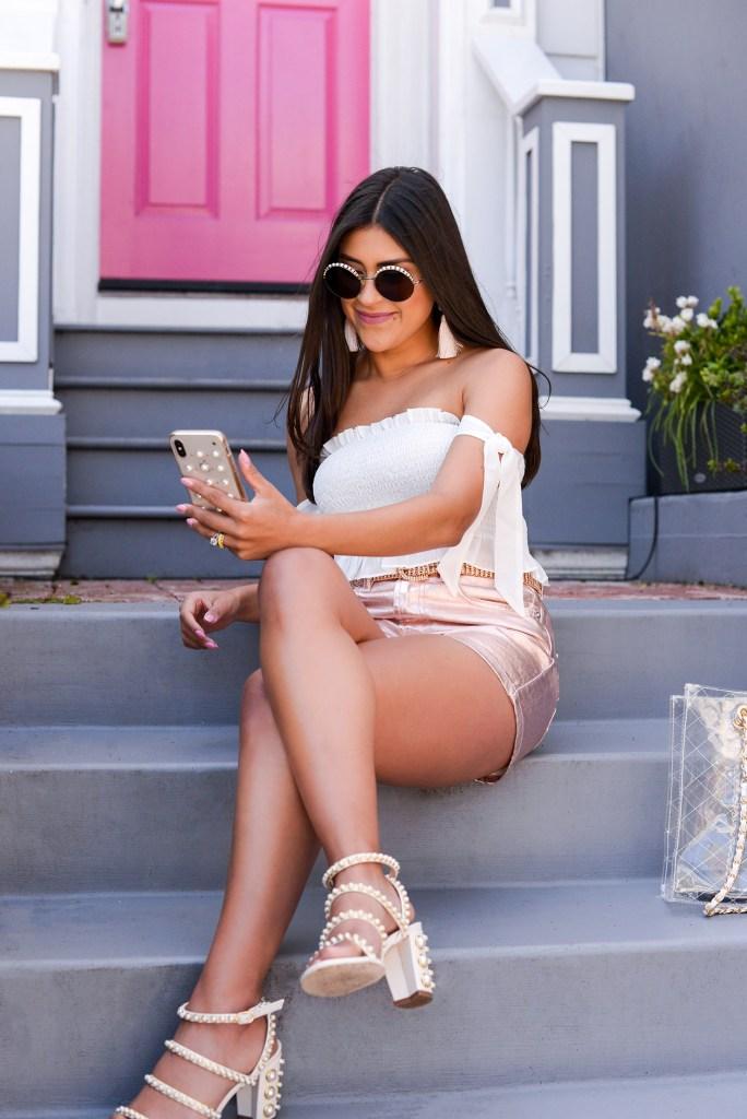Lifestyle blogger Kelsey Kaplan of Kelsey Kaplan Fashion wearing pink mom shorts and Stuart Weitzman pearl sandals