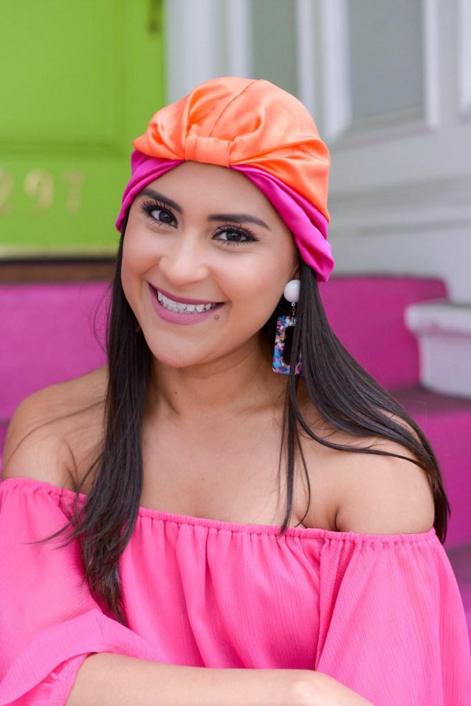 Lifestyle blogger Kelsey Kaplan of Kelsey Kaplan Fashion wearing off the shoulder romper and Silke head wrap.