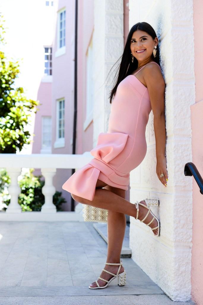 Lifestyle blogger Kelsey Kaplan of Kelsey Kaplan Fashion wearing Asos bow dress and pearl beaded purse.