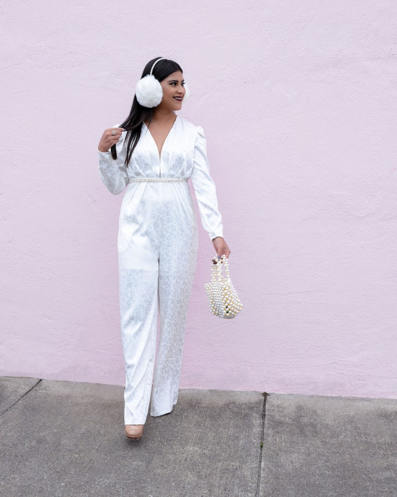Lifestyle blogger Kelsey Kaplan of Kelsey Kaplan Fashion wearing white snow leopard jumpsuit.