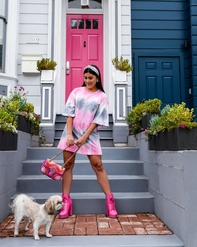 Lifestyle blogger Kelsey Kaplan or Kelsey Kaplan Fashion wearing tie dye t-shirt dress and pink Gucci purse.