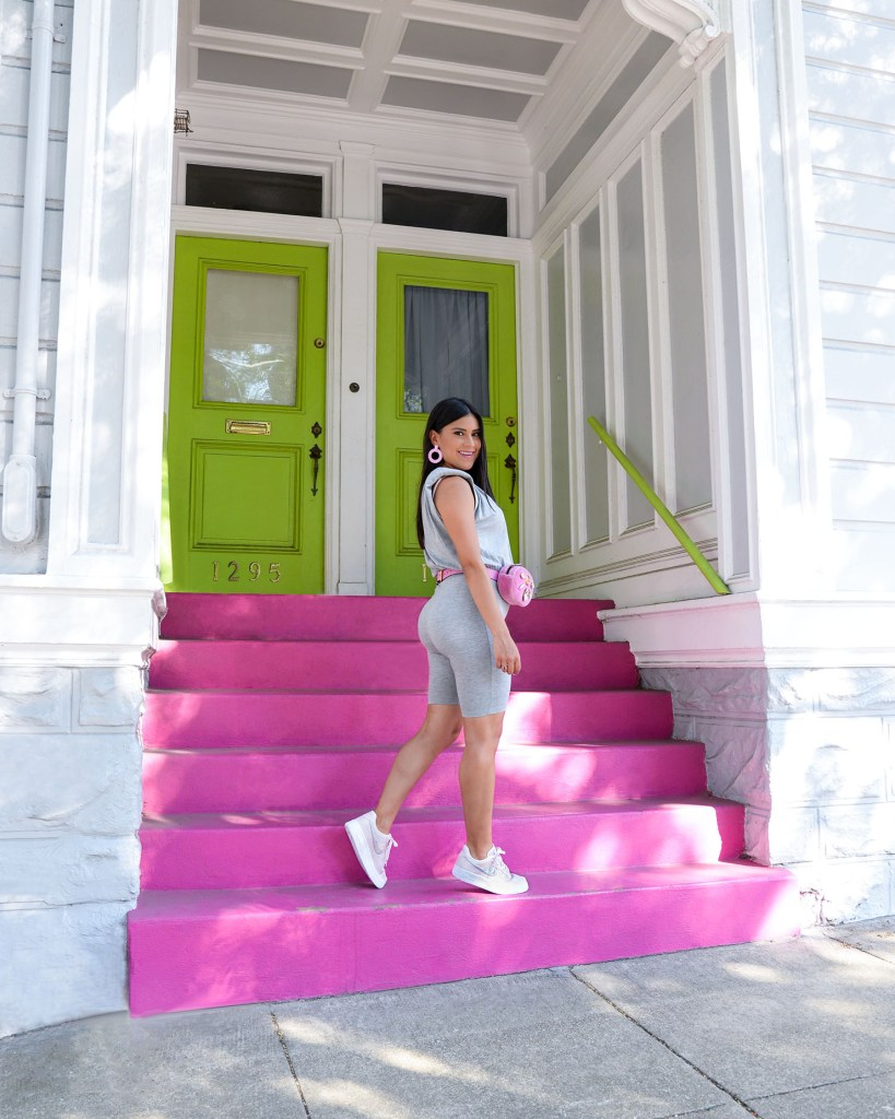 Lifestyle blogger Kelsey Kaplan in unitard and pink air force 1 sneakers