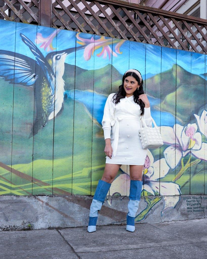 Lifestyle blogger Kelsey Kaplan of Kelsey Kaplan Fashion wearing pearl sweater dress and denim boots.